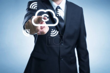 Businessman touching the cloud