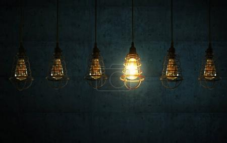 Photo for Hanging retro light bulbs decor on dark blue cement background with one isolated glowing . - Royalty Free Image
