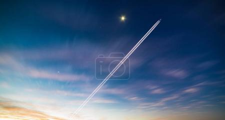 Airplane contrail in sky