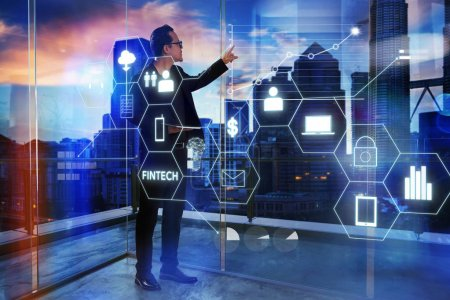 Businessman touching on digital virtual screen with fintech infographic icon . Hi-tech business concept .