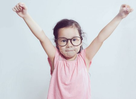 Portrait of young cute asian girl . Hands up pose .