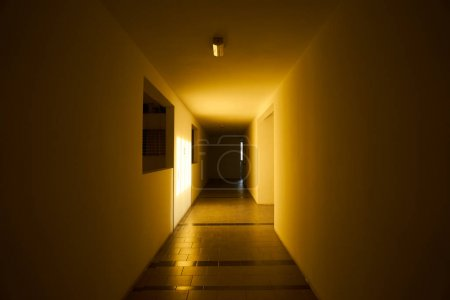 Photo for Empty apartment corridor with morning warm light and shadow . - Royalty Free Image