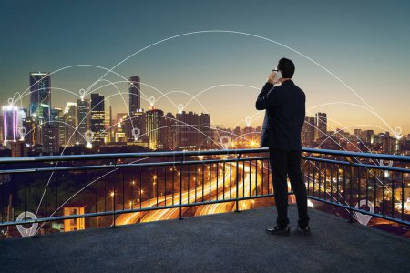 Photo for Businessman using phone on open terrace , modern city with internet connect with hotspot in downtown concept  background . - Royalty Free Image