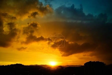 Dramatic blue and orange color cloudy sunset golden hour .