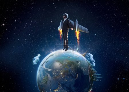 Businessman wear a rocket suit to lift from Earth planet , Business start up and travel concept .Extremely detailed image including elements furnished by NASA.