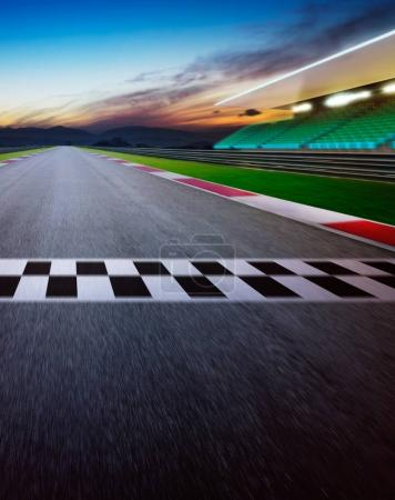 Motion blurred racetrack with start line. Night scene. Vertical poster format