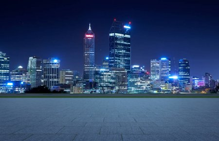 Photo for Empty square ground floor with city skyline background. Night scene . - Royalty Free Image
