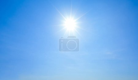 Photo for Shining sun with rays and clear blue sky background. - Royalty Free Image