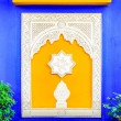 Постер, плакат: Colorful window in Jardin Majorelle former residence of fashion designer Yves Saint Laurent in Marrakesh Morocco Yellow window frames of the blue house of Yves Saint Laurent Museum of Islamic art