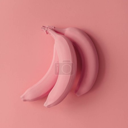 Photo for Raw Pink bananas on pink background. Minimal style - Royalty Free Image
