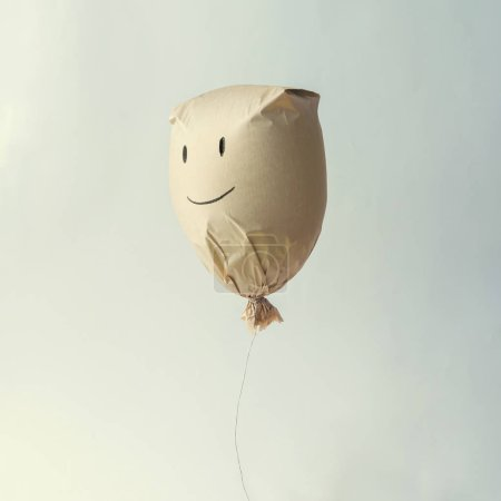 Paper bag balloon with smiley face