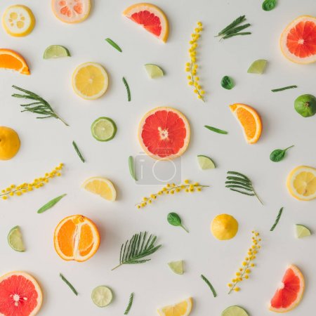 pattern of lemons and oranges with grapefruit and flowers