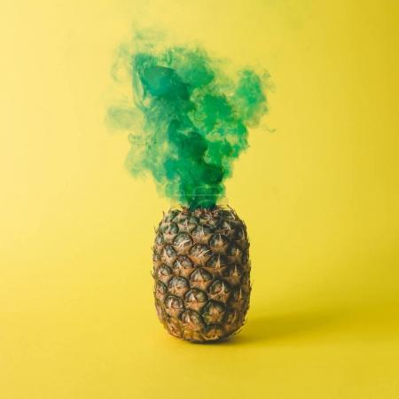 Pineapple with green smoke