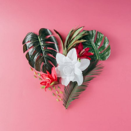 Photo for Tropical leaves and flowers in shape of heart. happy mothers day love concept - Royalty Free Image