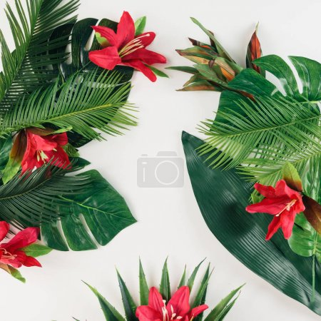 layout made of tropical leaves and flowers