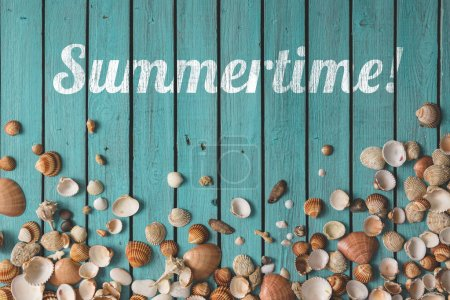 Photo for Pattern made of seashells on wooden background. Summertime concept - Royalty Free Image