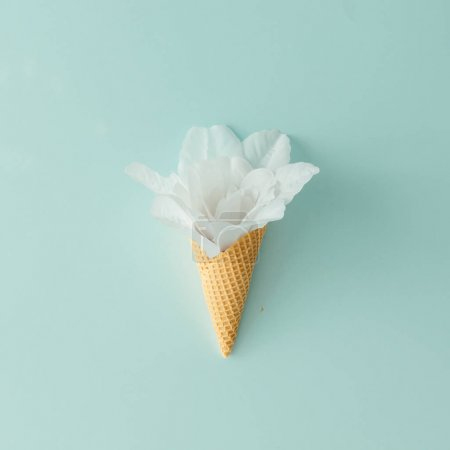 Photo for White flower in ice cream cone on pastel blue background. Summer tropical concept - Royalty Free Image