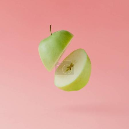 Photo for Sliced ripe apple on pastel pink background, Minimal fruit concept - Royalty Free Image