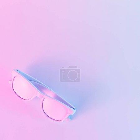 sunglasses in vibrant bold gradient purple and blue holographic colors. Concept art. Minimal surrealism.