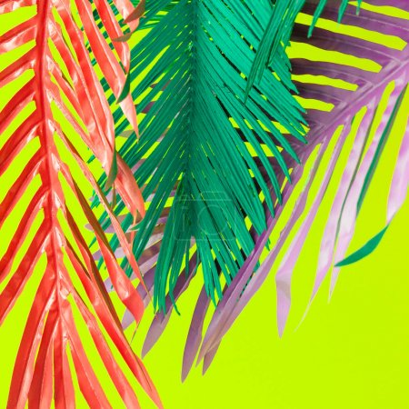 Photo for Colorful tropical leaves on vivid green background. Minimal summer exotic concept. - Royalty Free Image