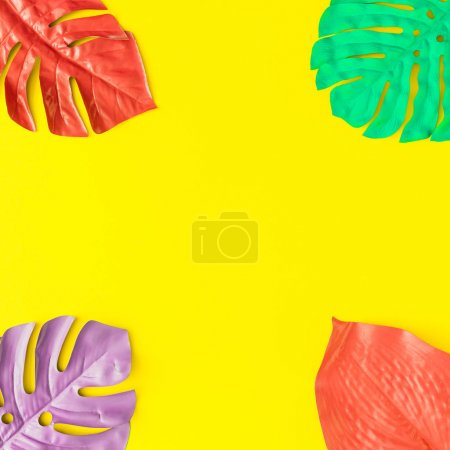 Photo for Painted tropical and palm leaves in vibrant bold colors. Concept art. Minimal summer colorful background. - Royalty Free Image