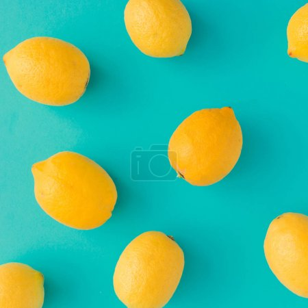 Photo for Creative summer pattern made of lemons on bright blue background. Fruit minimal concept. - Royalty Free Image