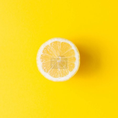 Photo for Lemon on vivid yellow background. Minimal summer concept. Flat lay. - Royalty Free Image