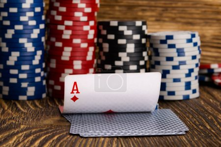 cards and poker chips, on a wooden background