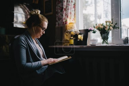 woman reading interesting book