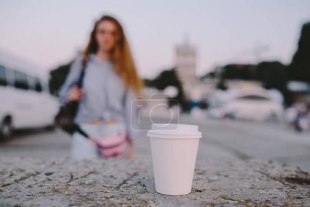 cup and woman on background