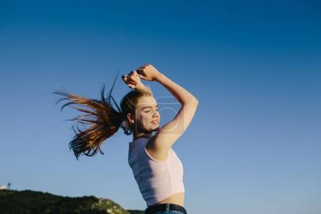 Photo for Happy young attractive sport woman jumping, enjoying life. jogging, training, fitness, healthy lifestyle, sports and wellness concept - Royalty Free Image