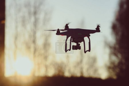 Photo for Drone flying in the sunset, winter scene - Royalty Free Image