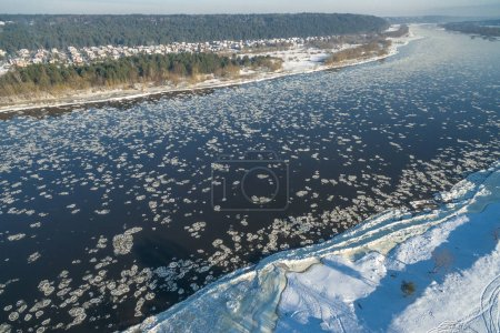 Winter river with ice floes