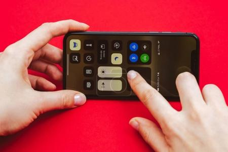 Holding in hand new Apple Iphone X flagship smartphone