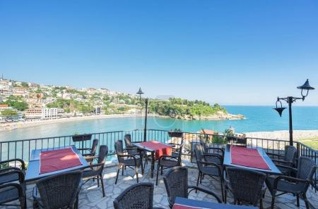 Photo for Restaurant terraces overlooking the sea of Ulcinj Old Town, Montenegro - Royalty Free Image