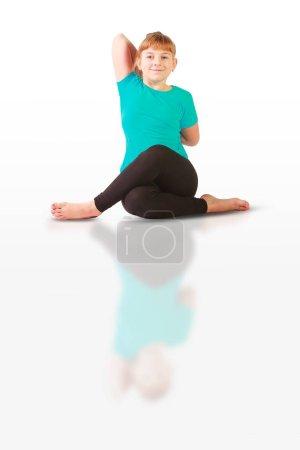 Beautiful flexible woman doing yoguna white backgr...
