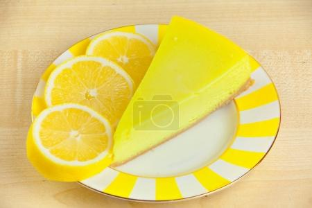 Delicious cheesecake with lemon  on a plate...