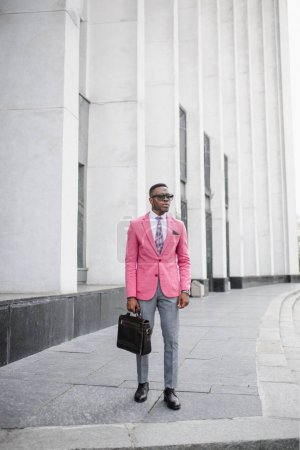 Handsome fashion afro-american man posing on new trendy look.