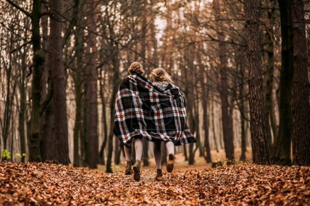 twins in autumn forest