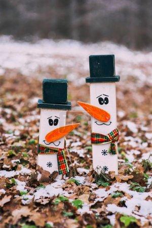 two wooden snowmen