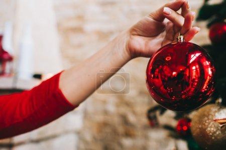 female hands holding christmas ball