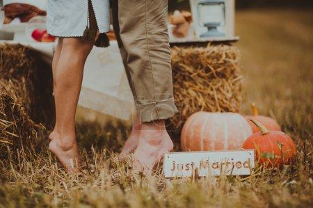 Lovers feet in hay field