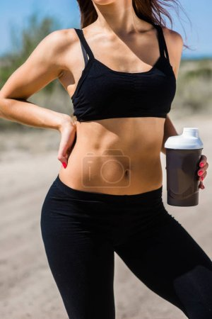 Fitness girl with shaker
