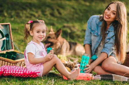 mother and daughter have picnic