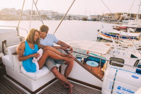 couple sitting on yacht deck