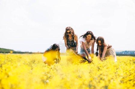 hippie girls in field