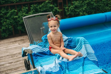 little girl on chair