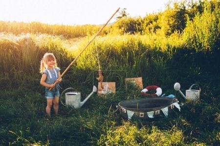 little girl playing fishing