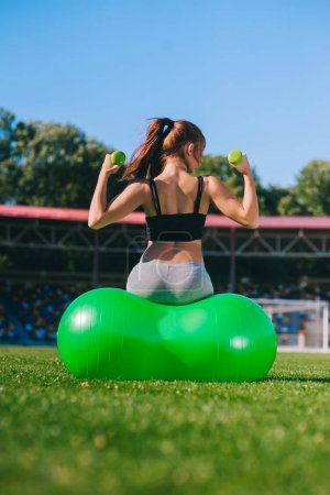 woman doing exercise with fit ball