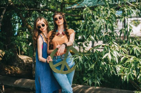 two girls with hippie symbol